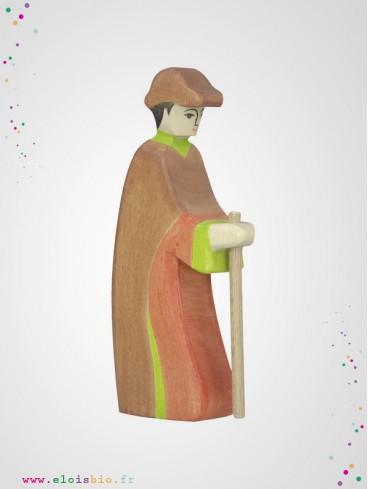 Berger avec bâton en bois